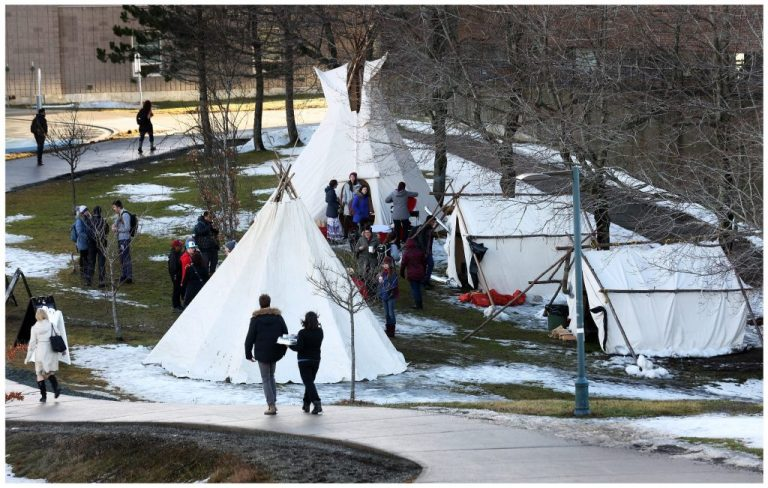 A tent gathering during winter orientation on the St. John's campus.