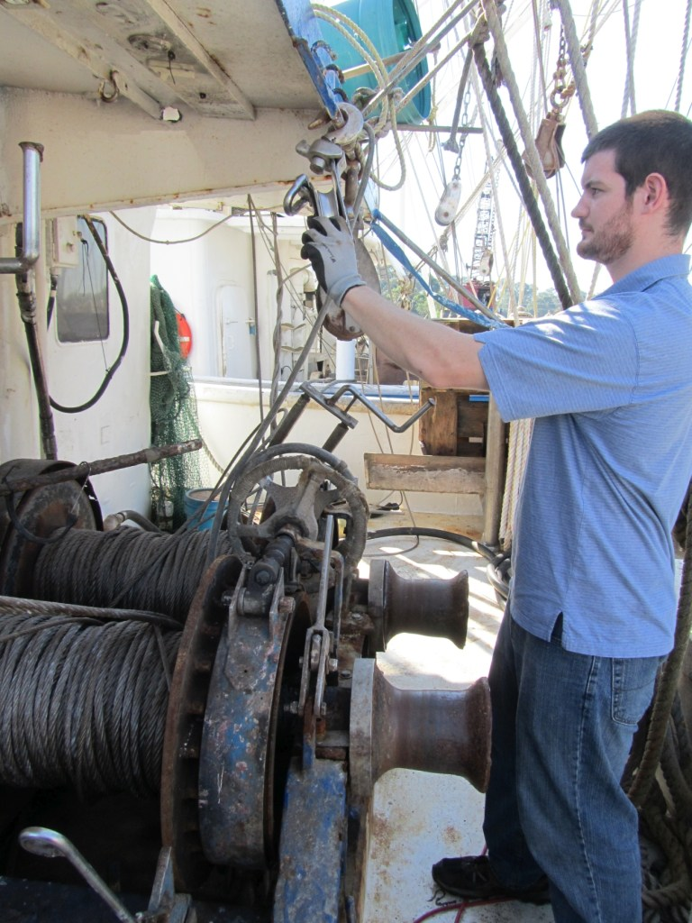 NIOSH Mechanical Engineer David Sweet takes measurements off a 503 McElroy winch aboard the fishing vessel Elisabeth T, operating out of Intercoastal City, Louisiana. Mr. Sweet will be at IFISH 5 discussing fixed guard designs for fishing deck winches.