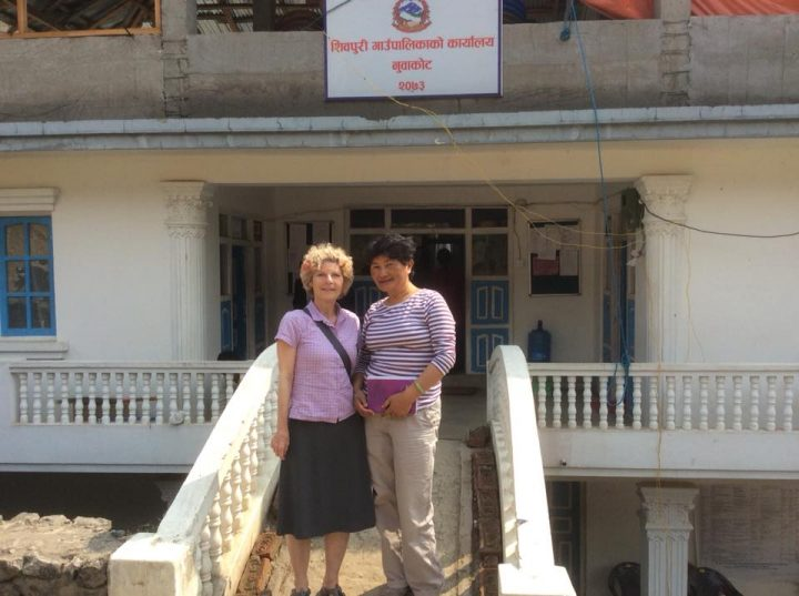 Two women standing in front of a building in Nepal