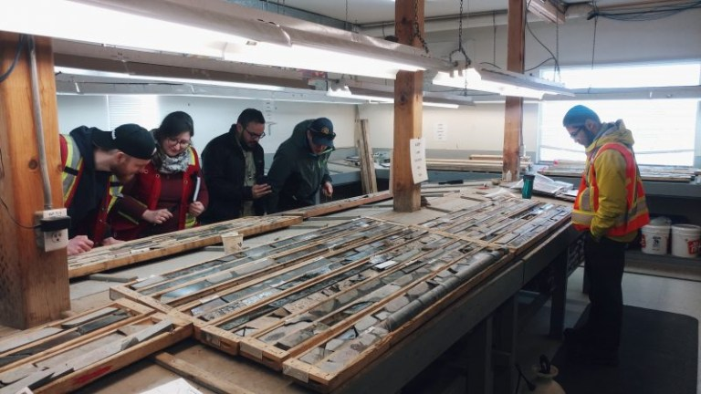 Students looking a core samples