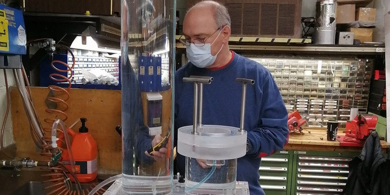 Dennis Cramm, division manager with the mechanical division of the Department of Technical Services, performs final check of a hydrostatic pressure test device before delivering to Dr. Lesley James' lab at Memorial.