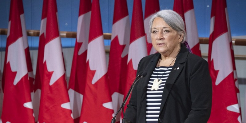 Governor General Mary Simon stands in front of Canadian Flags and stands at a podium during the July 6 announcement of her appointment.