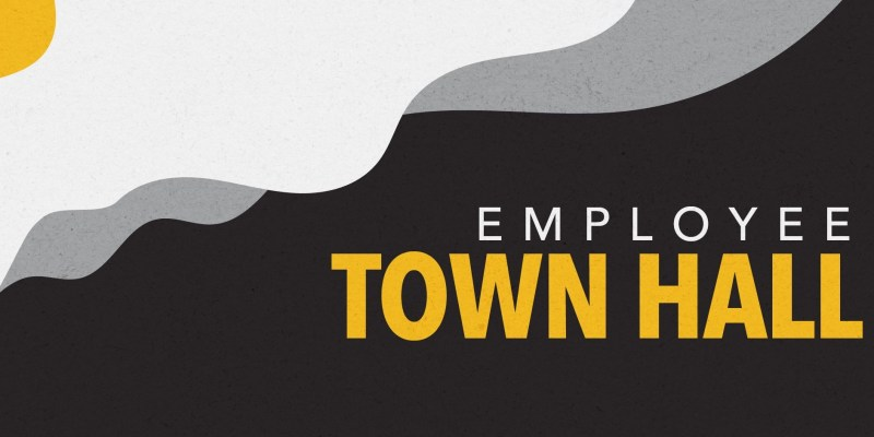 The words employee town hall is written in white and yellow text over a black background