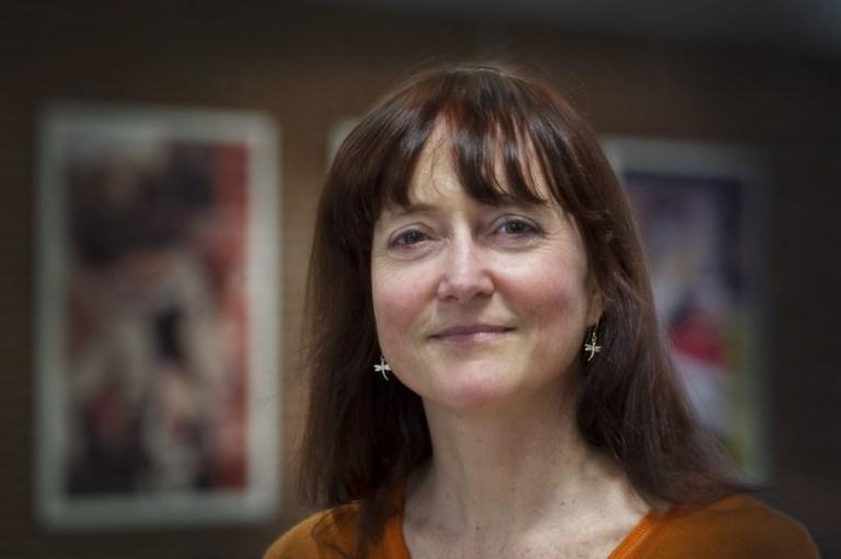Dr. Kelly Hawboldt wears an orange-coloured shirt.