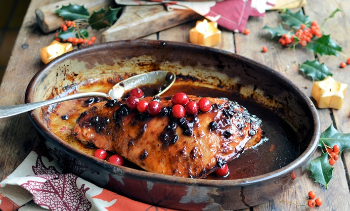Cranberry-glazed roast turkey breast with wild rice stuffing