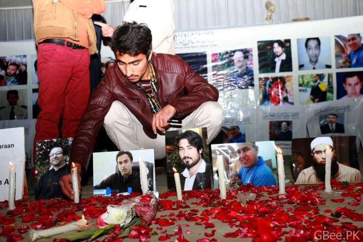 A young student is burning a candle outside Islamabad Press Club where a number of members from civil society of Chitral gathered for a candlelight vigil.