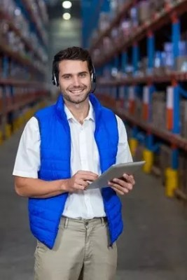 Business Insurance in English for Expats. GB Insurance Services Madrid. Worker in warehouse.