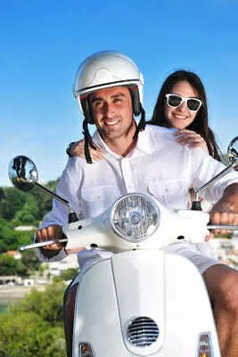 English speaking couple on motorcycle | GB Insurance Services | Madrid, Spain