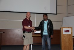 Graham presenting Kiran with his poster award.
