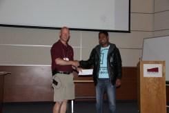 Graham presenting Kiran with his poster award.