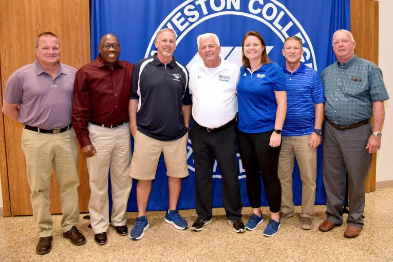 Coach Del, with friends and colleagues at his retirement