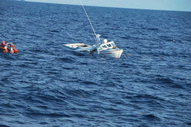 The 42-foot fishing vessel Sea Shepherd sinks approximately nine nautical miles northeast of Vieques, Puerto Rico, following a collision with the Coast Guard Cutter Key Largo, Tuesday, Sept. 23, 2014. U.S. Coast Guard Photo