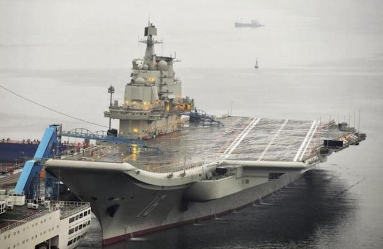 China's first aircraft carrier, which was renovated from an old aircraft carrier that China bought from Ukraine in 1998, is seen docked at Dalian Port, in Dalian, Liaoning province September 22, 2012. REUTERS/STRINGER