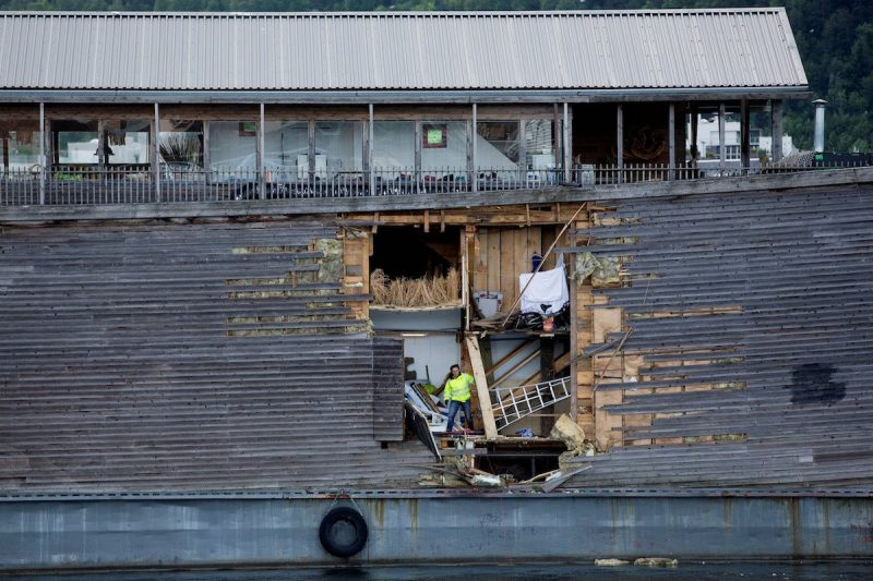 A crew member inspects damages on the hull of a full-size replica of the Ark of Noah after it crashed into a moored coast guard vessel in Oslo harbour, Norway June 10, 2016. NTB Scanpix/Hkon Mosvold Larsen/ via REUTERS ATTENTION EDITORS - THIS IMAGE WAS PROVIDED BY A THIRD PARTY. FOR EDITORIAL USE ONLY. NORWAY OUT. NO COMMERCIAL OR EDITORIAL SALES IN NORWAY.