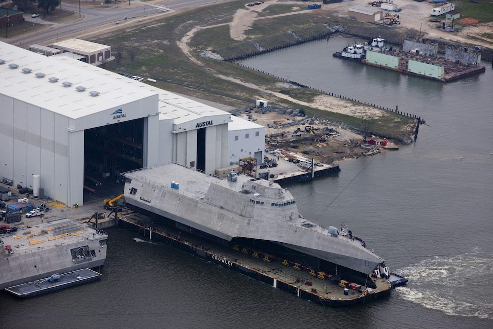 150224-N-EW716-002 MOBILE, Ala. (Feb. 24, 2015) An aerial view of the future littoral combat ship USS Gabrielle Giffords (LCS 10) during its launch sequence at the Austal USA shipyard. The launch of the Gabrielle Giffords marks an important production milestone for the littoral combat ship program. (U.S. Navy photo/Released)
