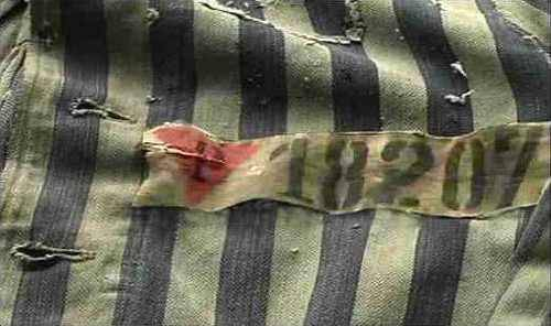 Concentration camp uniform with the pink triangle
