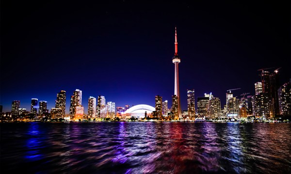 The night skyline of Toronto, Canada which is one of the lgbt friendly places that the irish diaspora can travel to instead of the US
