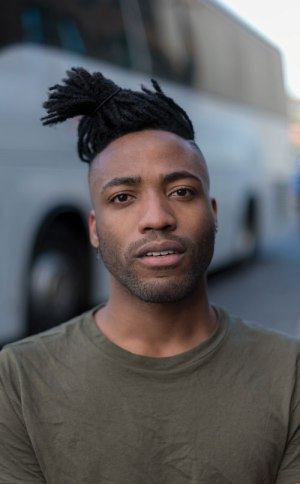 Jordan (a gay man of colour) poses for a photo as he discusses racism in Ireland