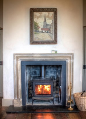 A roaring fire in a fireplace at one of the Irish Landmark Trust venues - the same Irish Landmark Trust who has a Valentine's Giveaway