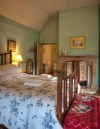 A bedroom with a bed and lamp at one of the Irish Landmark Trust venues - the same Irish Landmark Trust who has a Valentine's Giveaway
