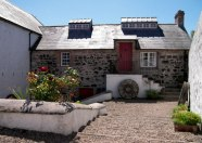 A gorgeous sunny stone cottage with a red door at one of the Irish Landmark Trust venues - the same Irish Landmark Trust who has a Valentine's Giveaway
