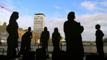 The silhouettes of women in Dublin with a suitcase as part of Will St Leger's Out of the shadows art project