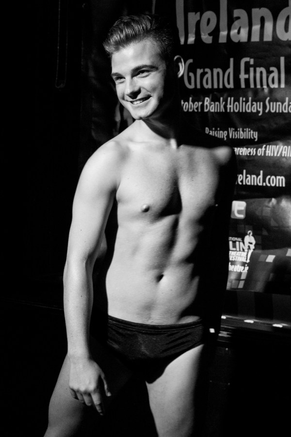 Stephen Lehane in swimwear in black and white as the winner of Mr Gay Ireland 2017