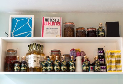 Jars and ingredients on shelves at the cake cafe and slice which are both owned by Ray O'Neill