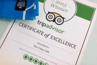A TripAdvisor certificate of excellence at the cake cafe and slice which are both owned by Ray O'Neill