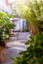 A lovely outdoor area surrounded by greenery at the cake cafe and slice which are both owned by Ray O'Neill