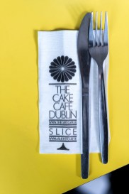 The Cake Cafe Dublin napkin with a knife and fork on it at the cake cafe and slice which are both owned by Ray O'Neill