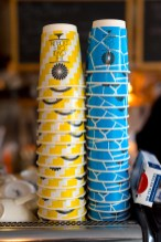 Yellow and blue coffee takeaway cups at the cake cafe and slice which are both owned by Ray O'Neill