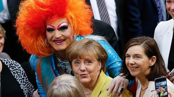 angela merkel and a redhaired drag queen