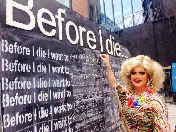 belfast, panti bliss writes 'before i die..i want to get married in belfast' on a chalk board