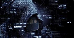 A hooded figure with lines of code flowing around them and the Boards.ie logo after personal details leaked because moderators deleted homophobic hate speech from boards