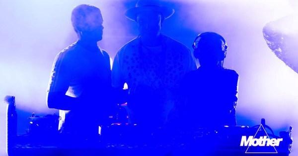 The Mother DJs shrouded in violet light