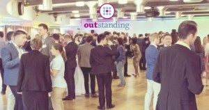 One of the outstanding events with people talking and the company's logo in the centre