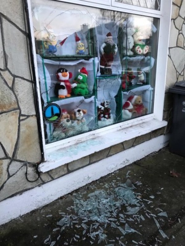 Photo of the damaged window of Francis Timmons' home in Clondalkin. The glass has been smashed and it covers the ground underneath.