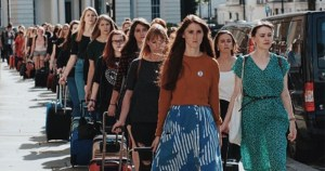 Repeal the 8th London Irish Abortion Campaign: Women are lined in rows of 2 with suitcases in hand