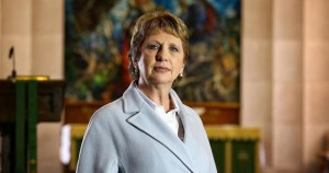 mcaleese stands in the middle of a church
