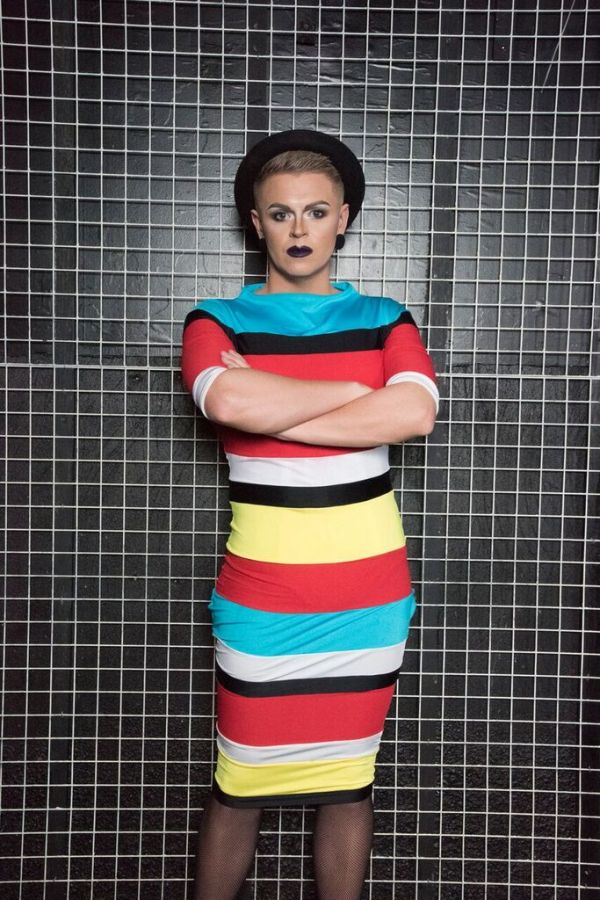Paul Ryder poses in a striped dress