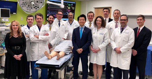 Surgeons of most complex penis and scrotum surgery pose for a photo