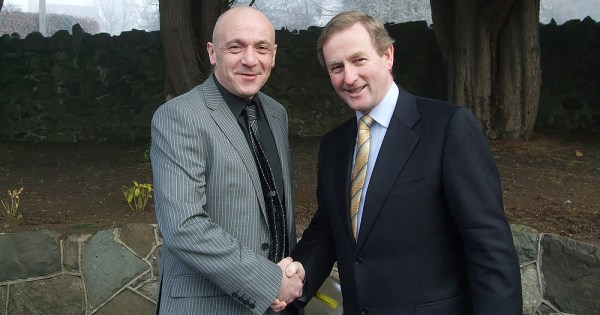 First Openly Gay MLA John Davis pictured shaking Enda Kenny's hand
