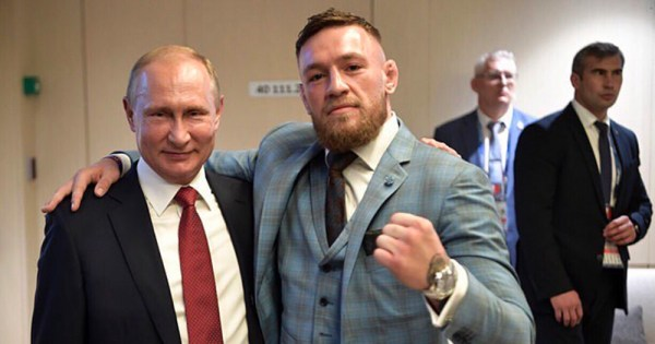 Putin and Conor McGregor pose for a photo
