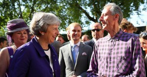 Theresa May and Peter Tatchell pictured outside Downing Street