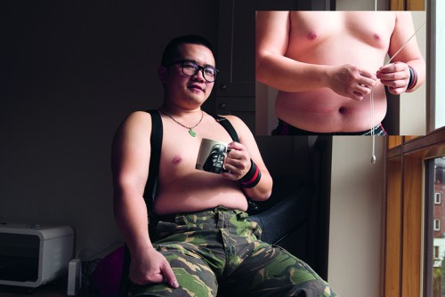 Photo project based on Grindr users - the photo shows a man sitting on a chair holding a mug