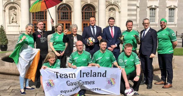 Athletes competing at the Gay Games pose with the Taoiseach and several ministers