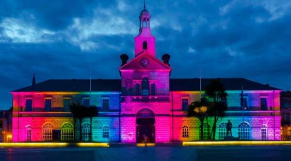 Northern Ireland town hall lit up in rainbow colours