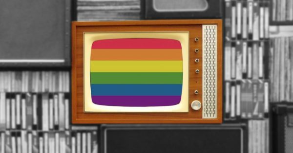 An old TV shows with a rainbow flag on the screen against a black and white background
