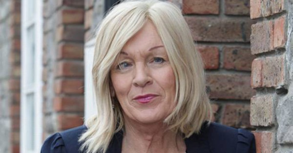 Irish trans woman Louise Hannon leaning against a wall